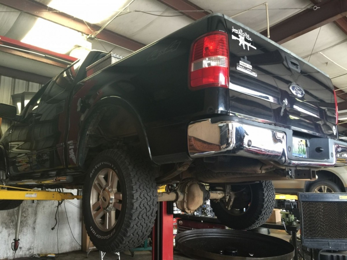 truck on lift in shop